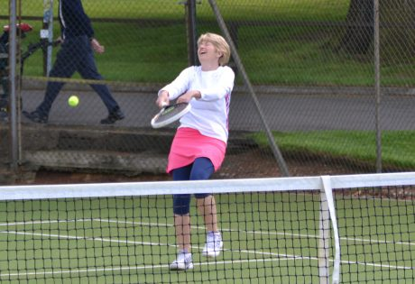 older women playing tennis