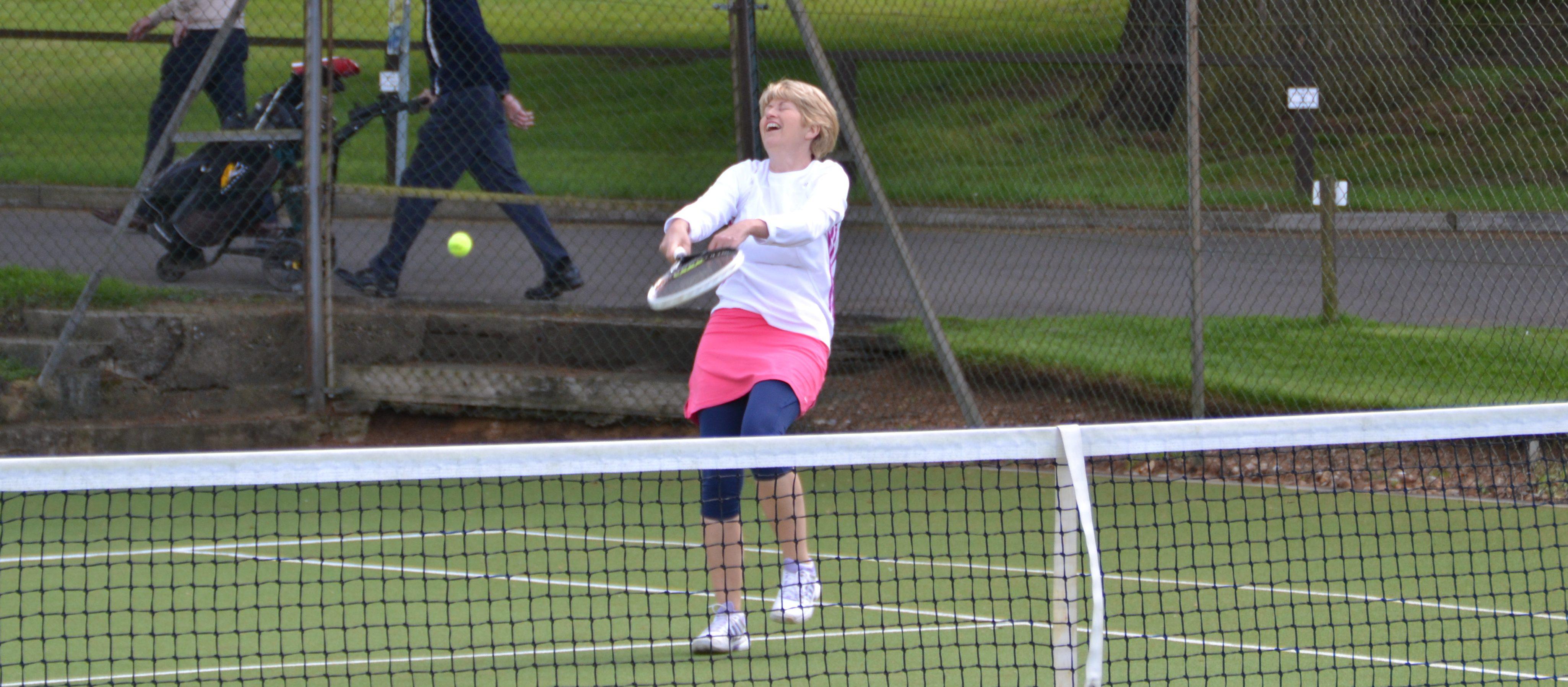 older women playing tennis