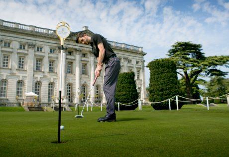 Mnn on practice golf green