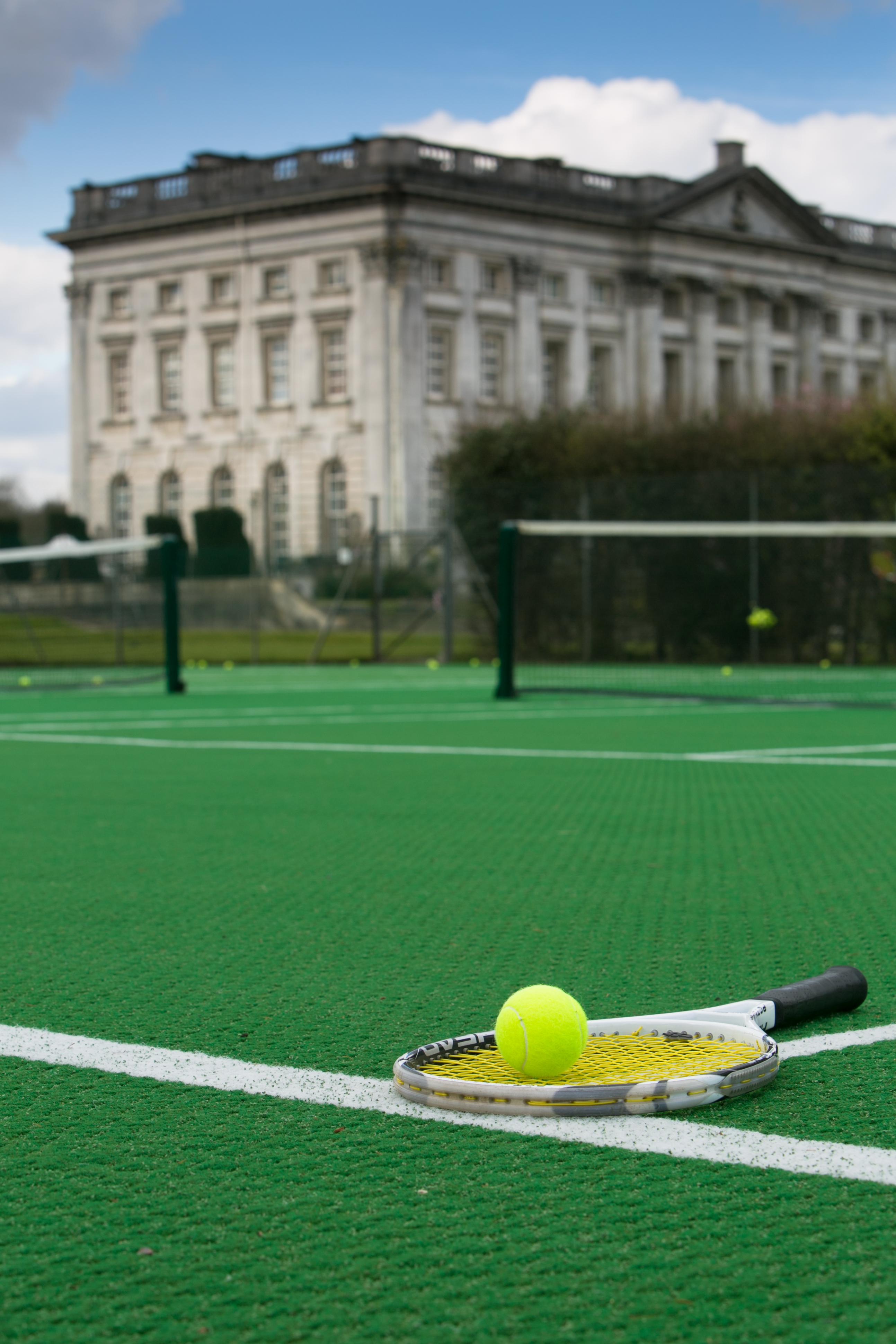 Tennis racket on claytex court