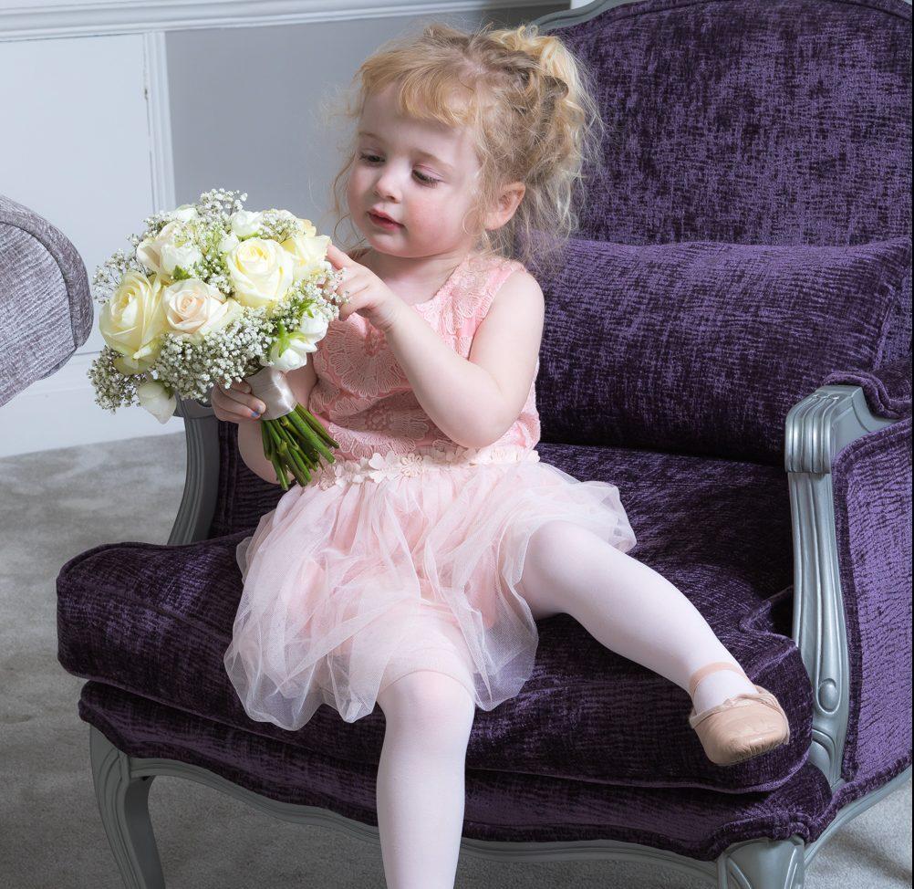 Flower girl in bridal room