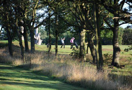 Man playing golf shot