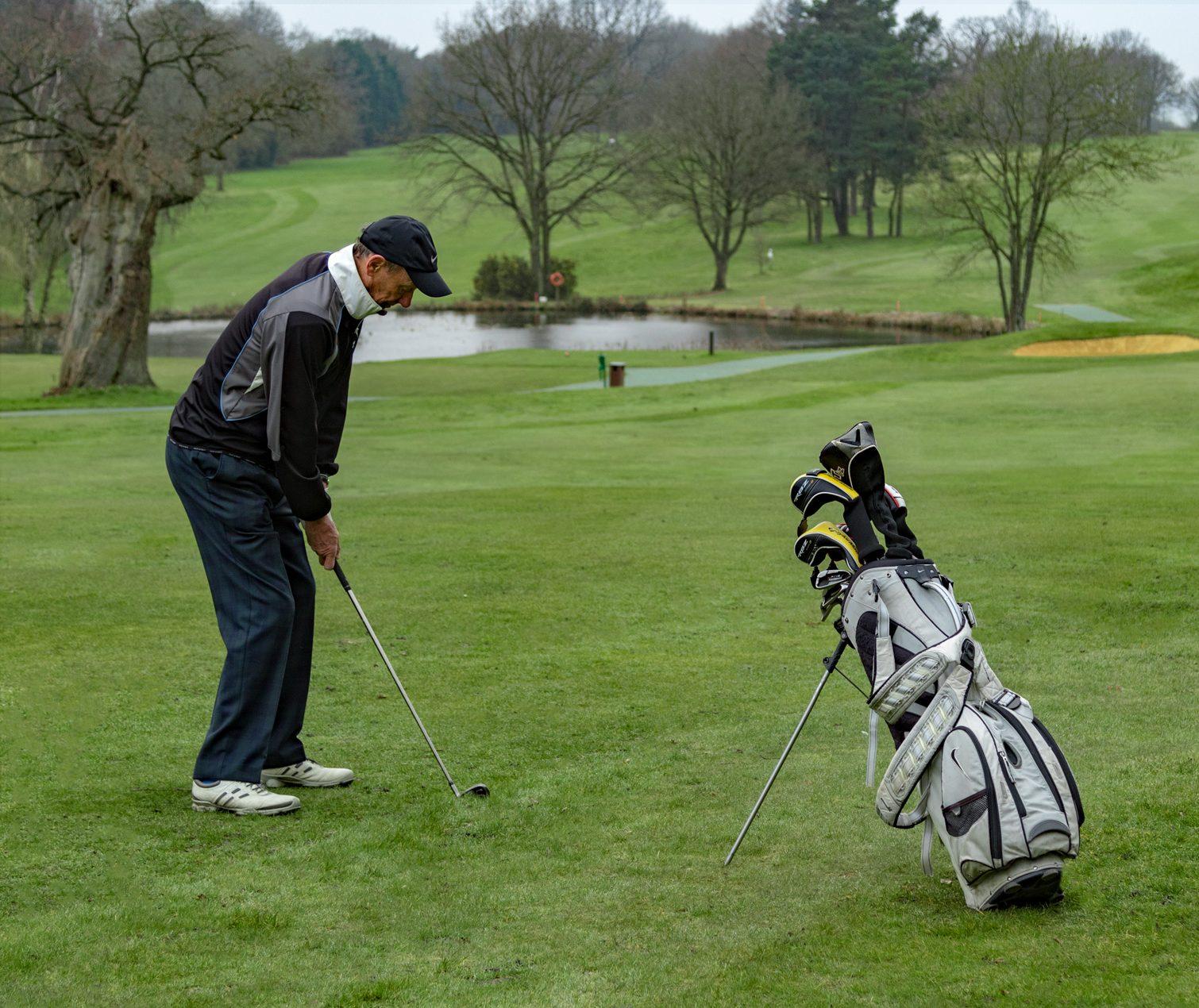 Male Golf Iron shot on fairway