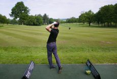 Golfer on driving range