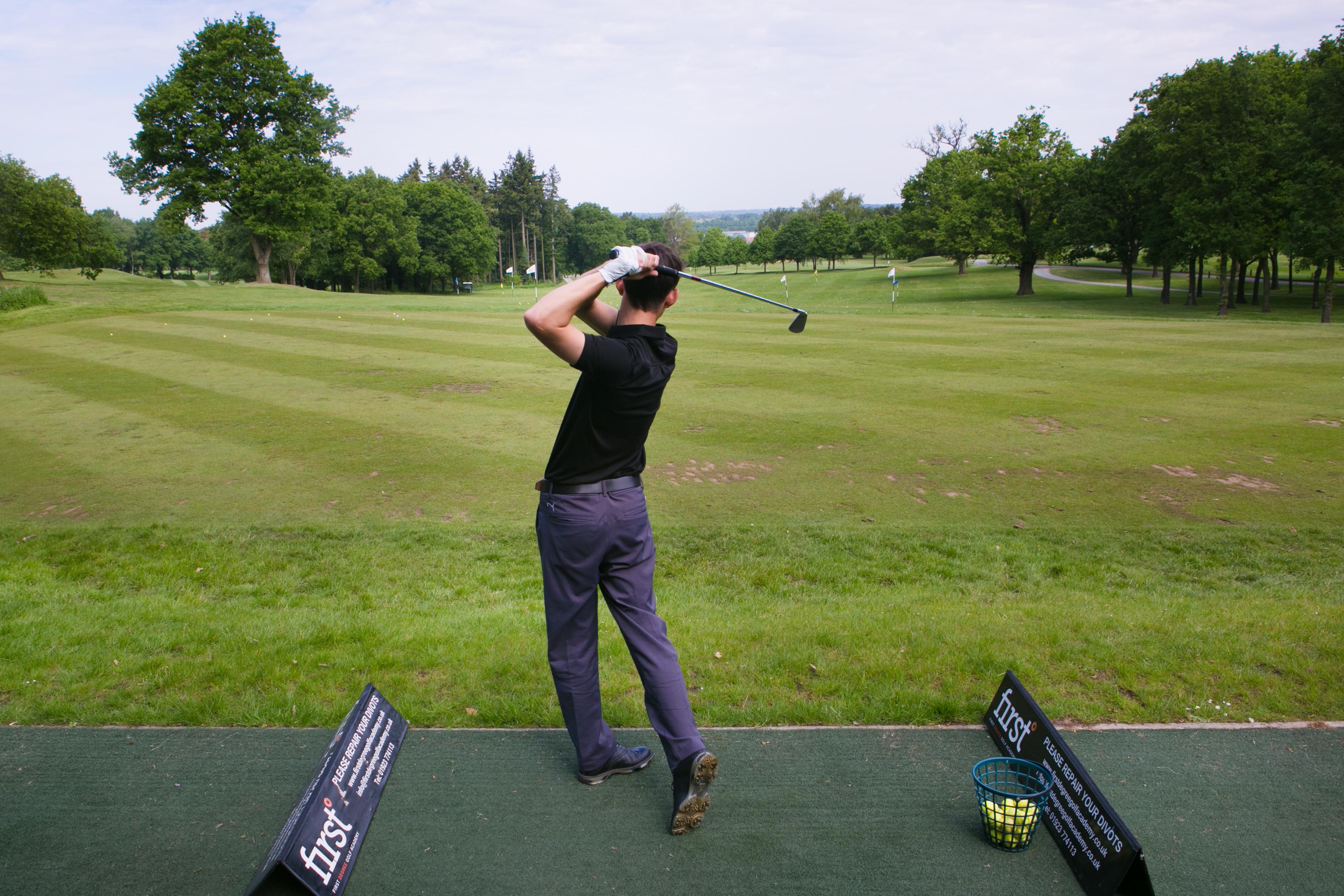 Golfer on driving range